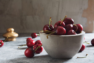 Fresh Cherries on a Concrete Table