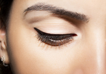 Closeup of woman eye  with black eyeliner