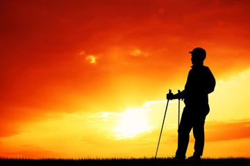 trekking silhouette at sunset