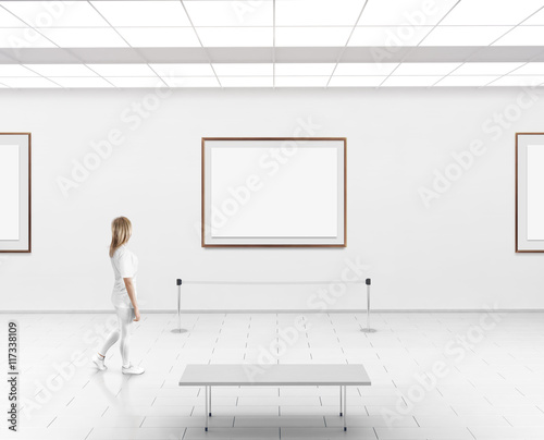 Modern gallery wall mockup woman walk in museum hall with blank modern gallery wall mockup woman walk in museum hall with blank wall with frames sciox Images