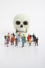 miniature figurines crowd of people and skull