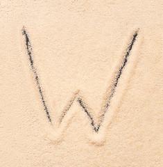 W letter written on sand