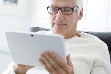 Senior man using a digital tablet