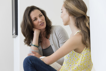 Mature woman talking to her daughter