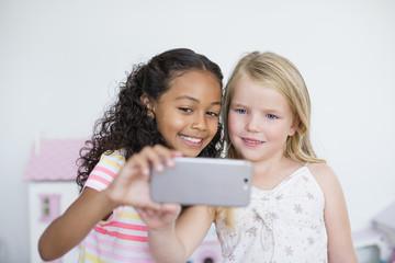 Two girls taking selfies