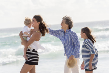 Happy multi-generation family enjoying on beach