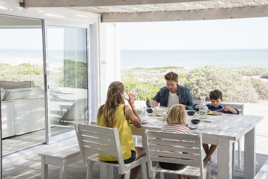Family having lunch on patio