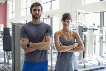 Portrait of a young couple standing in health club