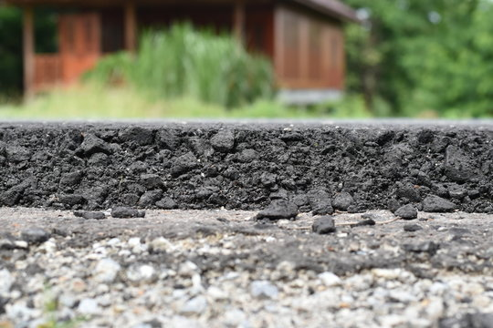 Cross section of asphalt road (top layer is an asphalt and bottom layer is an crushed rock )
