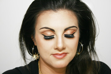 Girl with brown eye makeup with closed eyes