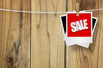 Sale paper label on wooden