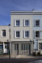 Three storey painted town house with integral garage,  London, UK.