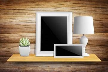 Empty picture frame on bookshelf.