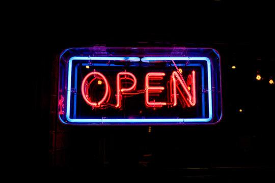 neon OPEN sign welcomes customers