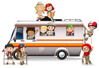 Children riding on van