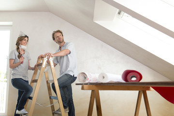 Man woman couple renovating home decorating