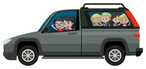Children riding on pick-up truck