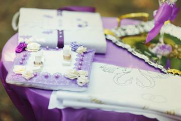 Wedding rings and purple wedding decorations