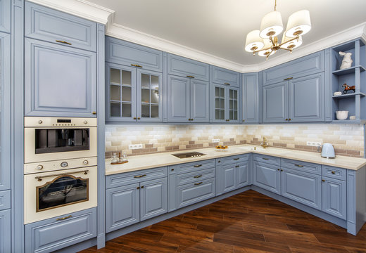 kitchen interior with appliances and furniture blue