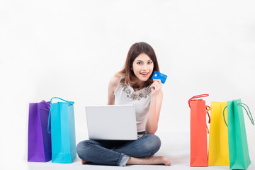 Young asia woman thinks about credit shopping with shopping bag, isolate on white background with copy space