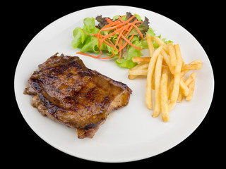 Teriyaki chicken steak served with french fries and salads to vegetables isolated on the black background with clipping path