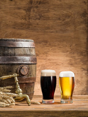 Wall Mural - Glasses of  beer and ale barrel on the wooden table. Craft brewe