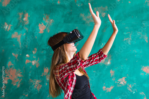 9c1a07cb280c Smile happy woman getting experience using VR-headset glasses of virtual  reality much gesticulating hands