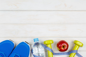 Fitness and dieting concept idea on white wood background.