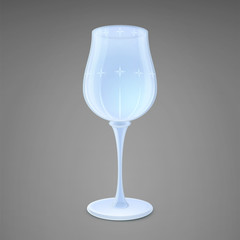 Wine glass. Isolated on a gray background. Shiny crystal with a pattern.
