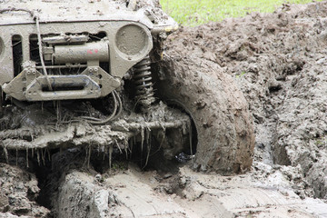 Muddy Off-road vehicle driving through mud on 4x4 Offroad race