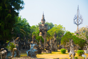 ancient statues and sculptures of hindu and buddhism gods in Buddha Park, Vientiane, Laos