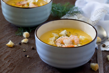 Mashed vegetable soup and shrimp with garlic and green dill on a