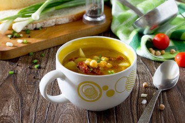 Vegetarian vegetable soup with chickpeas, potatoes and sundried