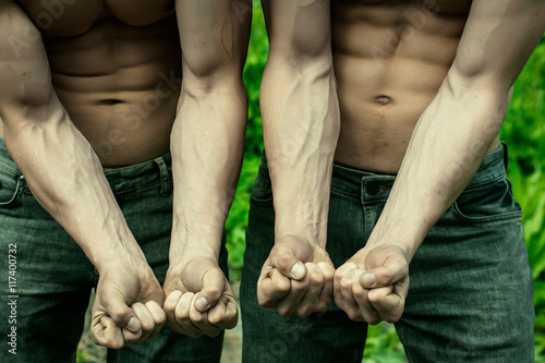 Muscular guys with veins on hands\