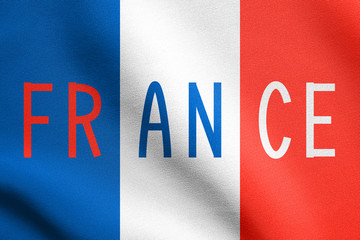 French flag and word France with fabric texture