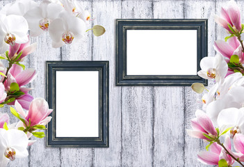 Magnolia flowers with orchidea and photo frame
