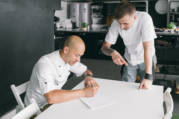 Student and chef at table
