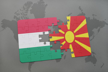 puzzle with the national flag of hungary and macedonia on a world map background.