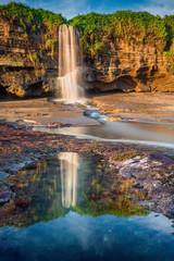 Beautiful waterfall near the beach at Melasti Beach, Bali, Indon