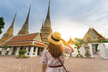 Tourist is visiting Wat Pho in Bangkok, Thailand.