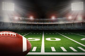 american football ball on green field