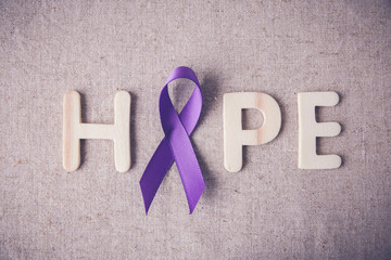 Purple ribbon with HOPE wooden letter, toning, Alzheimer's disease, Pancreatic cancer, Epilepsy awareness, Hodgkin's Lymphoma awareness
