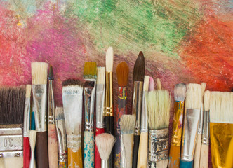 Brushes on a colorful background. The workplace of the artist. Banner for school