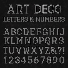 Font in art deco style. Vintage alphabet. White capital letters and numbers of dots and lines with flourishes on a black textured background.