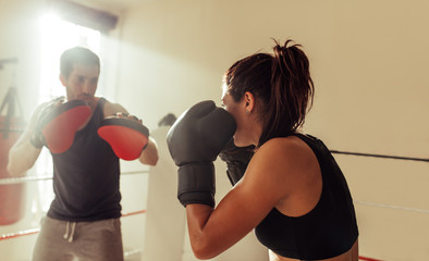 Trainer with focus pads and boxer in ring