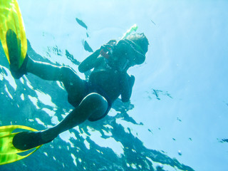 a boy diving with scuba and flipper