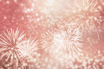 Fototapete - Defocused Rose gold fireworks and bokeh at New Year and copy space. Abstract background holiday.