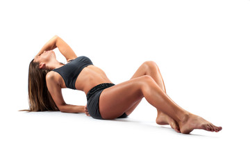 Woman practicing Yoga in a Studio
