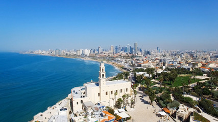 Tel Aviv's modern skyline with Jaffa's ancient port and old city - Aerial image