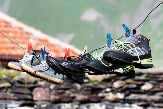 Drying shoes and boots attached to a line with clothes pins